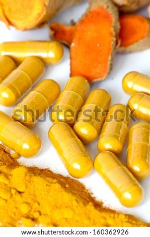 Turmeric (Curcuma longa L.) root and turmeric powder for alternative medicine ,spa products and food ingredient. - stock photo