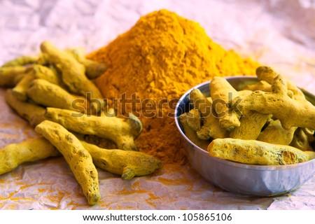 Turmeric powder and turmeric sticks - stock photo
