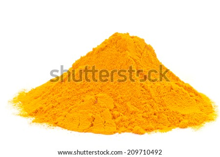 Turmeric powder heap isolated on white background
