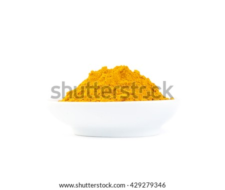Turmeric powder in the White bowl on white background.with a copy space for text. - stock photo