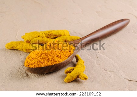 turmeric powder , indian spice,Turmeric powder and sticks  - stock photo