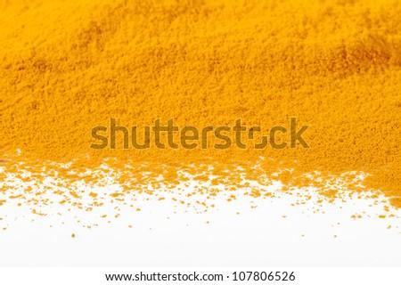 turmeric powder on white background - stock photo