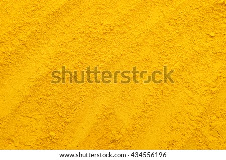 Turmeric powder texture background.