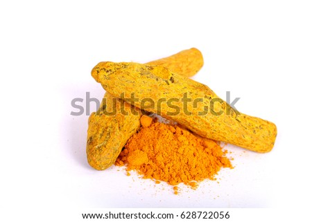 turmeric powder with fresh turmeric root in white