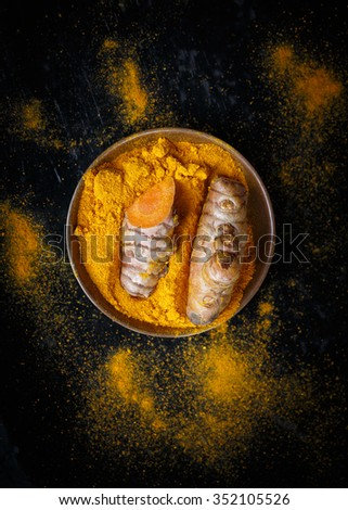 Turmeric roots and turmeric powder - stock photo