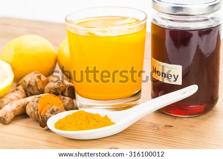 Turmeric roots with lemon and honey drinks, powerful healing beverage