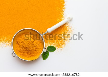 Turmeric spices on white texture background for decorate project. - stock photo