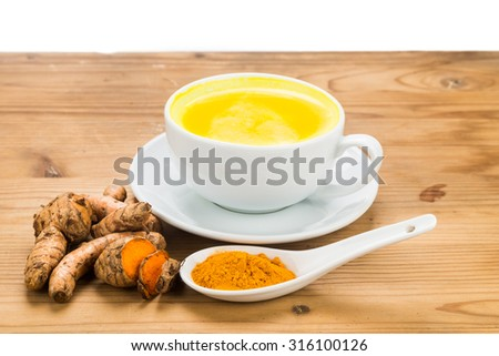 Turmeric with milk drinks good for beauty and health - stock photo