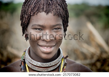 TURMI, ETHIOPIA - 12 AUGUST: portrait of unidentified Hamer tribe woman, Omo valley, 12 august 2014. Hamer woman usually comb their hairs with soil - stock photo