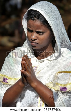 TURMI, ETHIOPIA - NOVEMBER 22, 2011: The woman prays during celebration in orthodox church. November 22, 2011 in Turmi, Ethiopia. - stock photo