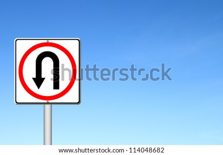 Turn back road sign over blue sky blank for text - stock photo