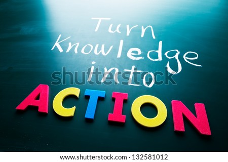 Turn knowledge into action, conceptual words on blackboard - stock photo