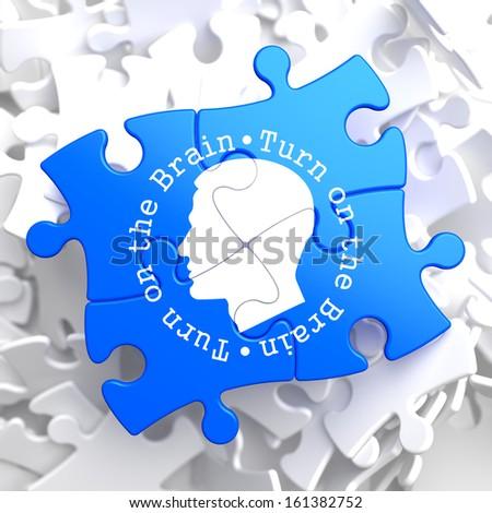 Turn On the Brain Written Arround Human Head Icon on Blue Puzzle. - stock photo