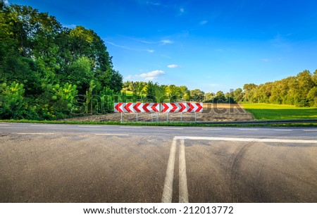 Turn signs on the crossroads - stock photo
