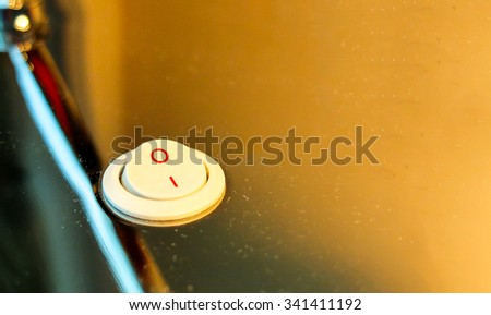 Turn The Light Off Concept, Electronic Light Switch at Corner in Turn On Stage with Orange Lamp Shade on Stainless Background as Copyspace to input Text used as Template - stock photo