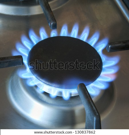 turned-on gas burner for large pan or wok - stock photo