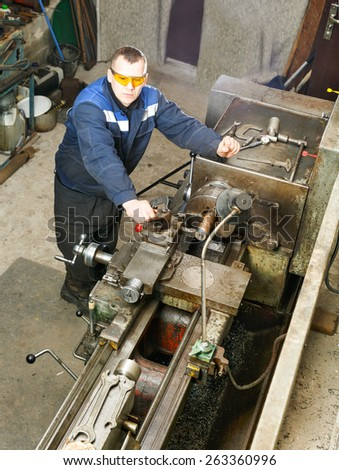 Turner is working on the machine.metal processing.  - stock photo