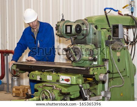 Turner is working on the machine.metal processing. Worker works on a lathe. Industrial area. - stock photo