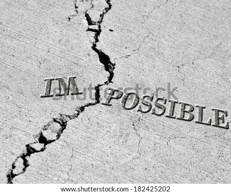 Turning impossible into the possible cracked cement symbol - stock photo