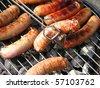 Turning Italian Sausage on Grill - stock photo