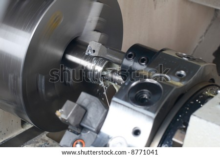 Turning lathe in action - stock photo