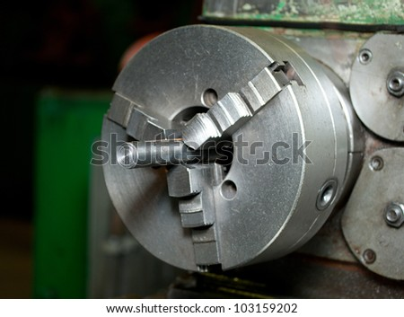 Turning lathe in the workshop - stock photo
