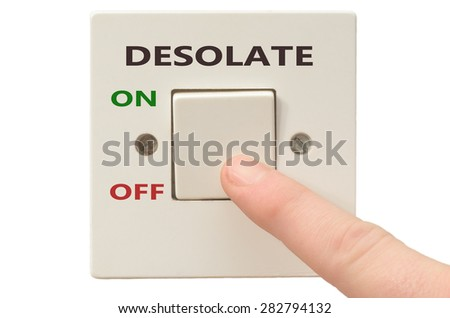 Turning off Desolate with finger on electrical switch - stock photo