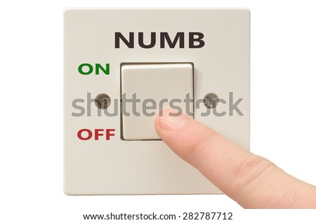 Turning off Numb with finger on electrical switch - stock photo
