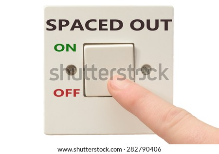 Turning off Spaced out with finger on electrical switch