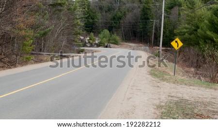 Turning sign at roadside, Tobermory, Ontario, Canada - stock photo