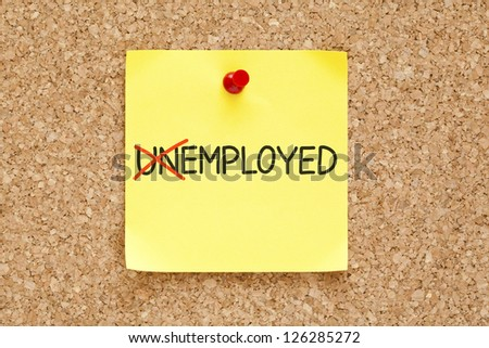 Turning the word Unemployed into Employed with red marker on yellow sticky note pinned with red push pin. - stock photo