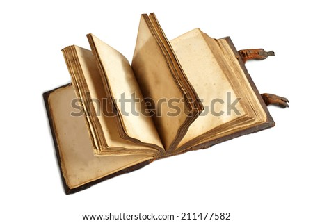 Turning yellowed blank pages of old book - stock photo
