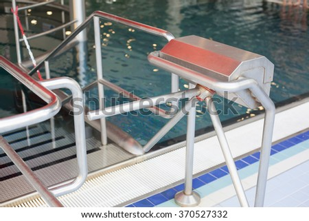Turnstile at the entrance to the pool complex (Shallow DOF). - stock photo