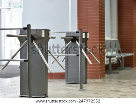 Turnstile controlling access to the building - stock photo