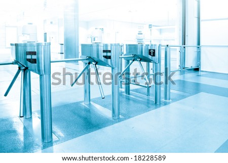 Turnstile entrance and exit gates at big event or trade center in blue tone