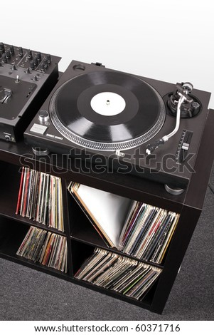 Turntable and Dj mixer on black table,closed-up in studio - stock photo