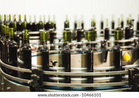 Turntable of a bottle filling line at a modern winery - stock photo