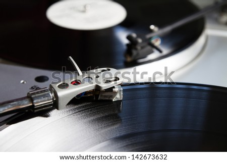 Turntable player with musical vinyl record. Useful for DJ, nightclub and retro theme. - stock photo