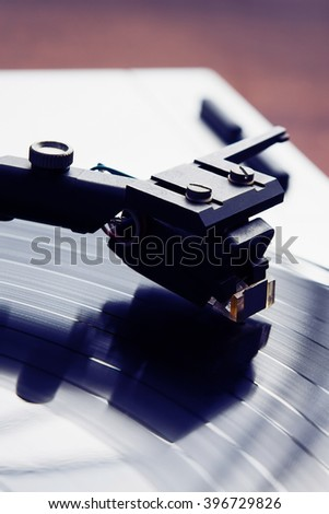 Turntable player with musical vinyl record. Useful for DJ, nightclub and retro theme. Violet color toning - stock photo