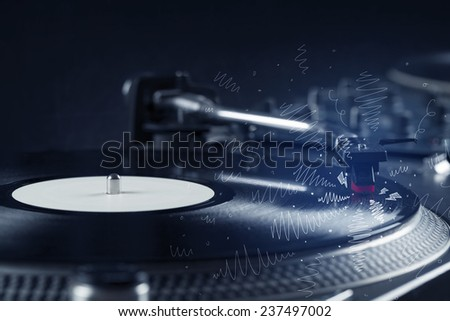 Turntable playing music with hand drawn cross lines concept on background - stock photo