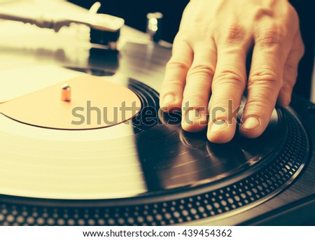 turntable scratch, hand of dj on the vinyl record - stock photo