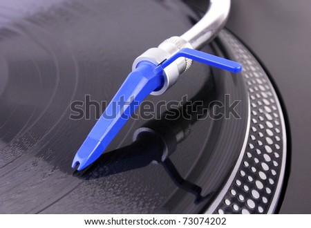 Turntable with blue needle, closeup