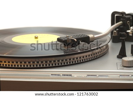 Turntable with vinyl record with yellow label isolated on white closeup - stock photo