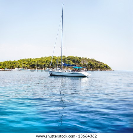 turquoise Adriatic sea with yacht - stock photo