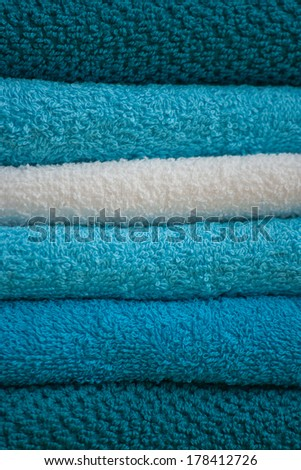 turquoise and white bath towels stack, close up - stock photo