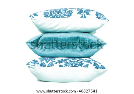 Turquoise and white cushions against white background - stock photo