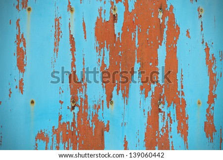 Turquoise background board with peeling paint - stock photo