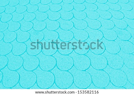turquoise background with fish-scale pattern - stock photo