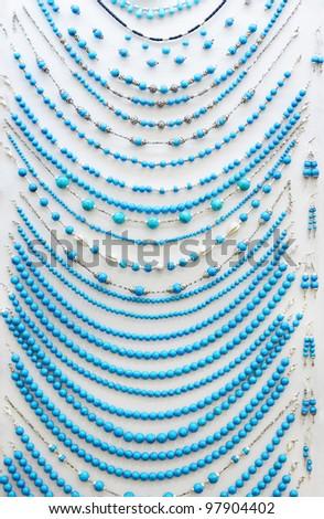 Turquoise beads on white background - stock photo