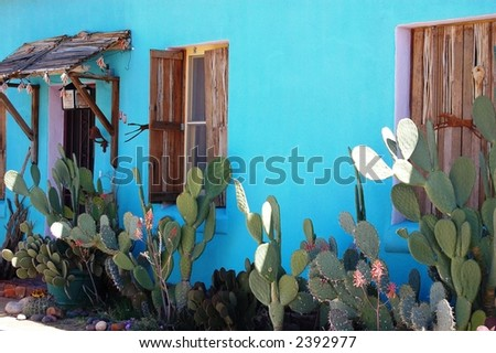 Turquoise Blue Adobe in Barrio District, Tucson, Arizona - stock photo